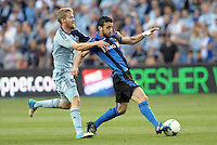 KANSAS CITY, KS - June 1, 2013:<br /> Felipe (7) midfield Montreal Impact held by Oriol Rosell (20) midfield Sporting KC.<br /> Montreal Impact defeated Sporting Kansas City 2-1 at Sporting Park.