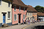 Morris Dancers walking up Bolford Street past traditional Essex homes. The Thaxted Morris Ring. Thaxted, Essex England. 2006