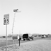 Why, Arizona<br /> USA.August 22, 2007<br /> <br /> At a junction that leads only to a remote US Mexican border crossing, a line of black and white SUV's loaded with American men in dark suits and glasses speeds for the border.