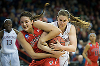 SPOKANE, WA - MARCH 30, 2013: Sara James battles for possession during the third round NCAA Championships game matching Stanford vs Georgia at the Spokane Arena. The Cardinal fell to the Bulldogs 61-59.