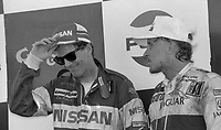 Price Cobb, right, talks with Chip Robinson in Victory Lane  after driving his Castrol Racing Jaguar XJR-10 to victory in the IMSA GTP/Lights race at the Florida State Fairgrounds in Tampa, FL, October 1, 1989.  (Photo by Brian Cleary/www.bcpix.com)