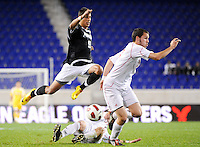 Marc Cintron (9) of the Providence Friars jumps over a tackle. The Providence Friars defeated the Cincinnati Bearcats 2-1 during the semi-finals of the Big East Men's Soccer Championship at Red Bull Arena in Harrison, NJ, on November 12, 2010.