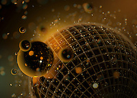 Abstract pattern of shiny gold spheres orbiting wire mesh sphere