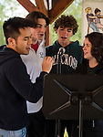 WATERTOWN, CT- 19 May 2016-051916EC08-  Members of the Holy Cross Choir (from L to R): Ted Huang, Liam Palilla, Greg Pomerleau and Megan Dreher perform during the Greater Waterbury Campership Fund's annual fundraiser Thursday night. The event was at the Greater Waterbury YMCA's Camp Mataucha in Watertown. All money raised goes directly to the cost of sending children to camp. Erin Covey Republican-American