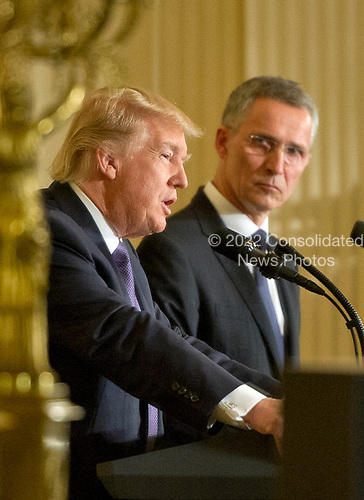 United States President Donald J. Trump and Secretary General Jens Stoltenberg of NATO are reflected in a mirror as they conduct a joint press conference in the East Room of the White House in Washington, DC on Wednesday, April 12, 2017.<br /> Credit: Ron Sachs / CNP