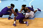 30 December 2014: North Carolina's Danielle Butts (10) gets a fist in the back of the neck from Albany's Margarita Rosario (above right) while they challenge for a loose ball with Albany's Imani Tate (12) and Tiana-Jo Carter (33). The University of North Carolina Tar Heels hosted the University at Albany Great Danes at Carmichael Arena in Chapel Hill, North Carolina in a 2014-15 NCAA Division I Women's Basketball game. UNC won the game 71-56.
