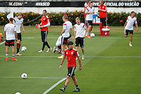 Germany manager Joachim Low with his team warming up behind