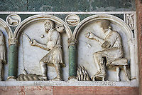 Late medieval relief sculpture depicting the labours for January and Feburary and astrological signs on the Facade of the Cattedrale di San Martino,  Duomo of Lucca, Tunscany, Italy,