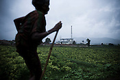 Vedanta Alumina Ltd. is seen in the background in Lanjigarh village, surrounded by the Niyamgiri hills in Orissa, India.