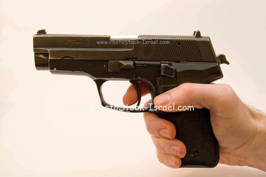 side view of a male hand holding a Czech CZ-99 9mm parabelum semi ...