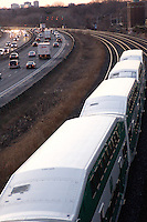 Commuter Train beside highway Toronto Ontario Canada