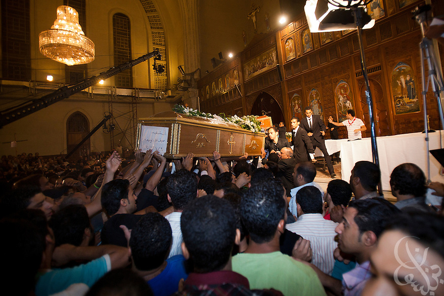 Egyptian Coptic Christians carry one of the coffins of the victims of sectarian violence during an October 10, 20011 funeral procession at the Coptic Cathedral  in Cairo, Egypt. At least 26 people, mostly Christian, were killed during sectarian clashes that saw the worst violence since the Revolution that toppled former Egyptian president Hosni Mubarak earlier this year. Egyptian Coptic Christians make up about 10% of Egypt's 80 million population and periodically violence flares between the Christian minority and the majority Muslim population. (Photo by Scott Nelson)