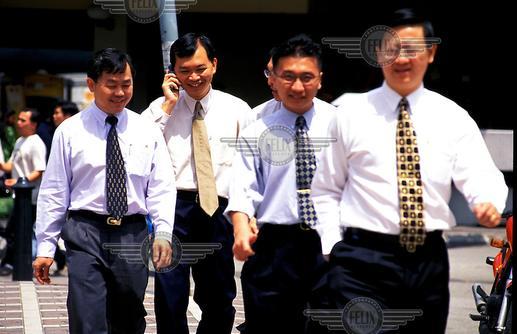 Ethnic-Chinese Malay businessmen on the streets of Kuala Lumpur, Malaysia's capital.  Credit: Chris Stowers.