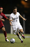 Duke's Danny Miller (3) tries to run past NC State's Ernesto Di Laudo (l) on Friday, October 21st, 2005 at Koskinen Stadium in Durham, North Carolina. The Duke University Blue Devils defeated the North Carolina State University Wolfpack 6-0 during an NCAA Division I Men's Soccer game.