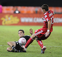 D.C. United defender Chris Korb (22) goes down to defend the play against Chicago Fire defender Gonzalo Segares (13). Fire defeated D.C. United 2-1 at RFK Stadium, Saturday October 15, 2011.