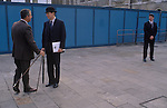 Household Cavalry Officer in Bowler Hat preparing for the Lord Mayors Show,using measuring stick, one pace, planning walking distance time.  London Uk Circa 1985