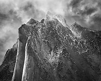 Monolith peak photographed as clouds cleared following a long storm.<br /> <br /> &quot;May your trails be crooked, winding, lonesome, dangerous, leading to the most amazing view. May your mountains rise into and above the clouds.&quot;  ~Edward Abbey