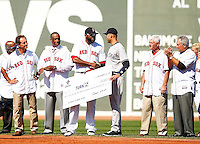 Derek Jeter #2 of the New York Yankees is presented with a check for his Turn 2 Foundation from David Ortiz #34 of the Boston Red Sox during pregame ceremonies at Fenway Park in Jeter's final career game on September 27, 2014 in Boston, Massachusetts. (Photo by Jared Wickerham for the New York Daily News)