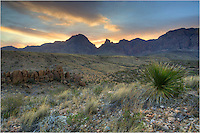 From west of the Window View, the sun begins to light up the sky in Big Bend National Park.