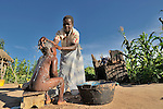 Florence Shawa bathes her son with water she carried home from a well in the village of Thundira, in northern Malawi.