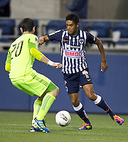 Sergio Santana, right, of CF Monterrey tries to get past Zach Scott of the Seattle Sounders FC during a CONCACAF Champions League match at CenturyLink Field in Seattle Tuesday Oct. 18, 2011. CF Monterrey won the game 2-1.