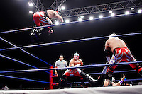 A Luchador (fighter) jumps from the ropes onto an opponent, held down by his team mates. Lucha Libre is a style of wrestling started in Mexico in 1933. The name means Free Fight, and matches tend to be focussed on spectacle and theatre with fans cheering for their favourite characters, who wear masks while jumping from the ropes, flipping opponents, and occasionally crashing into the crowd..&copy;Jacob Silberberg/Panos/Felix Features.