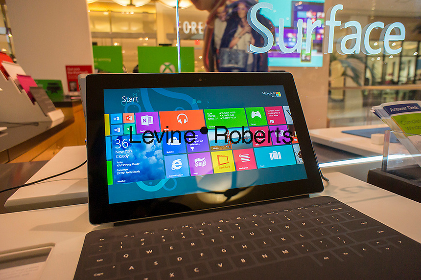 Surface tablets on display in the Microsoft kiosk in the Queens Center Mall in the borough of Queens in New York on Sunday, December 15, 2013 looking for bargains. A study by the National Retail Federation says that $600 billion in holiday purchases will be made by Americans, accounting for 19.3% of all retail sales. (© Richard B. Levine)