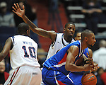 Mississippi's Terrance Henry (1), back, kncoks the ball away from SMU's Shawn Williams (2) as Mississippi's LaDarius White (10) looks on at the C.M. &quot;Tad&quot; Smith Coliseum in Oxford, Miss. on Tuesday, January 3, 2012. Mississippi won 50-48. (AP Photo/Oxford Eagle, Bruce Newman)