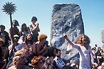1970's style hippies attend the second free festival at Stonehenge to celebrate the summer solstice June 21st 1975. John Pendragon in white went on to run the Tribal Messenger magazine. He died in 1998.