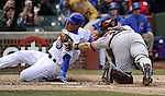 CHICAGO - APRIL  05:  Kosuke Fukudome #1 of the Chicago Cubs is tagged out at home plate by Miguel Montero #26 of the Arizona Diamondbacks in the second inning on April 5, 2011 at Wrigley Field in Chicago, Illinois.  The Cubs defeated the Diamondbacks 6-5.  (Photo by Ron Vesely) Subject: Kosuke Fukudome;Miguel Montero