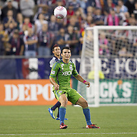 Seattle Sounders midfielder Servando Carrasco (23) controls the ball. In a Major League Soccer (MLS) match, the Seattle Sounders FC defeated the New England Revolution, 2-1, at Gillette Stadium on October 1, 2011.