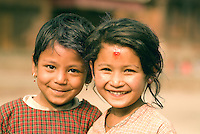Two young girls smile for the camera in Kathmandu. Kathmandu is the capital and largest city in Nepal. Nearly half the population of Nepal is under the age of 16.
