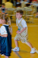 young boys & girls play in a church league basketball game, Richmond, VA, USA