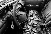 USA. Louisiana. New Orleans. Orleans Parish. 9th Ward area. The 9th Ward used to be the living place of the black (afro-american) community . Aftermath of hurricane Katrina. The interior of a car destroyed by the floods, like all houses of the area. The seats, the steering wheel and the windscreen are covered with dry mud. Automobile waste. Destruction of the urban american way of life. © 2005 Didier Ruef