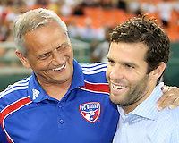 Head coach Ben Olsen of D.C. United with his opposite number, Schellas Hyndman of FC Dallas during an MLS match at RFK Stadium in Washington D.C. on August 14 2010. Dallas won 3-1.