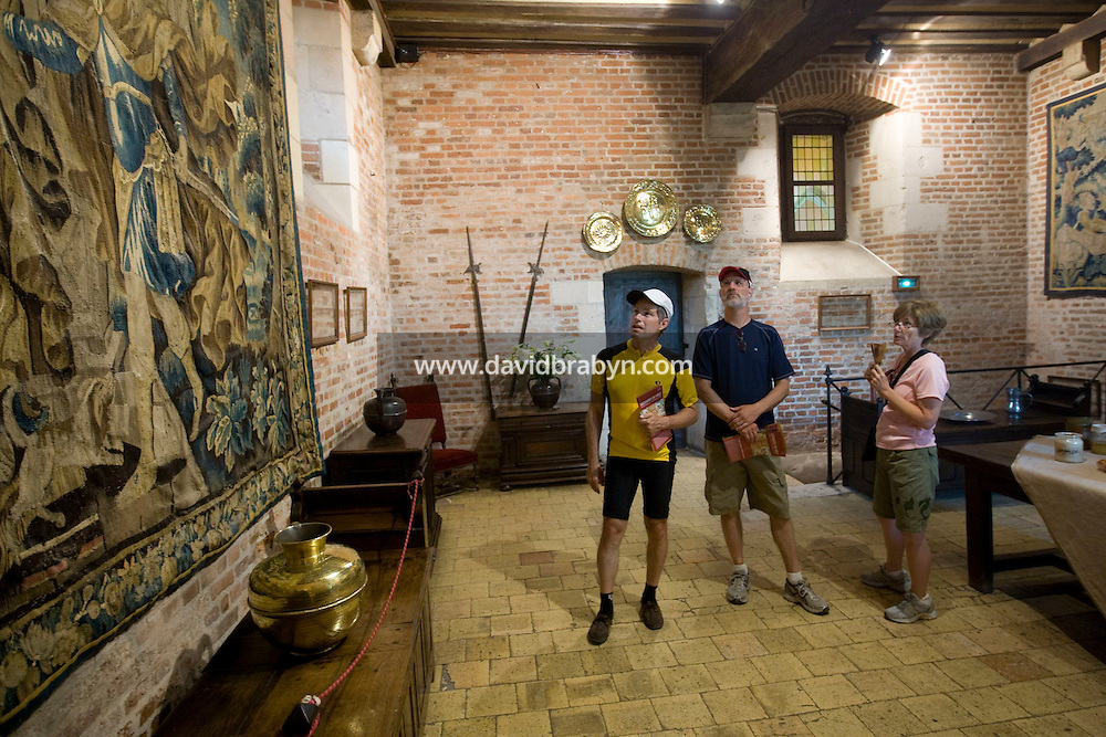 (LtoR) Larry Athan, Larry and Mary Brosky, participants in a Backroads cycle tour of the Loire Valley, visit a room in the Clos Luce mansion, Leonardo da Vinci's last home, in Amboise, France, 26 June 2008.