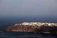 The village of Oia seen across the bay, Santorini, Greece