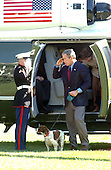 "Washington, DC - September 16, 2001 -- United States President George W. Bush salutes a Marine Guard as he returns from a week-end at Camp David on Sunday, September 16, 2001 with First Lady Laura Bush and their dogs Spot and Barney.  In his remarks to the press as walked to the White House,  President Bush warned ""We need to be alert to the fact that these evil-doers still exist""  and urged Americans to not let terrorism distract them from their normal routines..Credit: Ron Sachs / CNP"