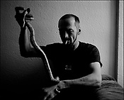 'GovanHell', portrait of a community. Davey and his snake, Govanhill, Glasgow, Scotland, UK. (Approx Date 2001)