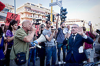 Roma 3 Giugno 2015<br /> Momenti di tensione al presidio anti-rom a Boccea, a Roma, cui hanno partecipato il movimento di estrema destra Casapound e alcuni comitati di quartiere. Una iniziativa contestata da antifascisti, e movimenti per la casa. Boccea &egrave; il quartiere dove mercoled&igrave; 27 maggio un'auto guidata da un 17enne  rom, ha investito nove persone e ucciso la 44enne filippina Corazon Abordo. Un funzionario di polizia con il megafono chiede agli anti-fascisti  di sciogliere il presidio, un manifestante con il megafono risponde negativamente.<br /> Rome June 3, 2015<br /> Moments of tension to the protest anti-Roma Boccea in Rome, attended by the far-right movement Casapound and some neighborhood committees. An initiative opposed by anti-fascists, and movements for the house. Boccea is the neighborhood where Wednesday, May 27 car driven by a 17 year old Roma, has invested nine people and killed the 44 year old Filipino Corazon Abordo. A police officer with the megaphone asking the anti-fascists to dissolve the garrison, a protester with megaphone responds negatively.