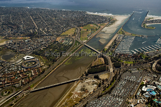 Aerial view of Smiley Lagoon near Mission Bay and San Diego, California, looking southwest. Smiley Lagoon is better known as Dog Beach, a leash free area where the San Diego River empties into the Pacific. It is located at the north-western boundry of Ocean Beach, a community of San Diego, California (goingoutside.com).