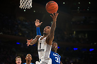 NEW YORK, NY - Thursday March 9, 2017: Duane Wilson (#1) of Marquette goes up for a basket against Angel Delgado (#31) of Seton Hall as the two schools square off in the Quarterfinals of the Big East Tournament at Madison Square Garden.