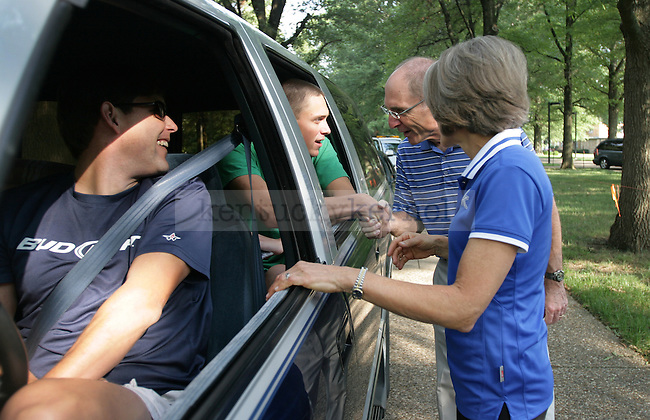 Incoming freshman Alex Grams shakes hands with UK President Dr. Eli Capilouto while his dad, Mike Grams, and Capilouto's wife, Dr. Mary Lynne Capilouto, look on, on Friday, Aug. 19, 2011, in Lexington, Ky. Photo by Becca Clemons | STAFF