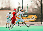 19 March 2011: University of Vermont Catamount LSM Max Gradinger, a Senior from Rancho Santa Fe, CA, is pursued by Attacker Kevin Cernuto, a Freshman from Neshanic Station, NJ, during action against the St. John's University Red Storm at Moulton Winder Field in Burlington, Vermont. The Catamounts defeated the visiting Red Storm 14-9. Mandatory Credit: Ed Wolfstein Photo