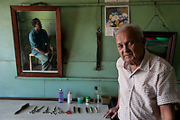 Mr. Gopaul, barber, in his salon in Mahebourg.