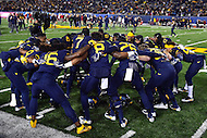 Morgantown, WV - NOV 19, 2016: West Virginia Mountaineers safety Khairi Sharif (7) gets his defense fired up before the game between West Virginia and Oklahoma at Mountaineer Field at Milan Puskar Stadium Morgantown, West Virginia. (Photo by Phil Peters/Media Images International)