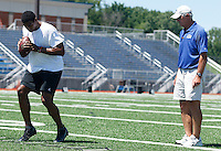 JEANNETTE, PA - AUGUST 12:  Quarterbacks coach Ken Anderson watches Terrelle Pryor as he works out at a practice facility on August 12, 2011 in Jeannette, Pennsylvania.  (Photo by Jared Wickerham/Getty Images)