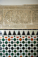 Arabesque Zellighe tiles with Mudjar plasterwork from tyhe vestibule of the Alcazar of Seville, Seville, Spain