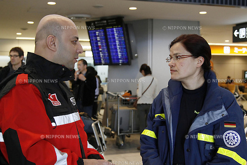 March 13, 2011, Narita, Japan - German rescue team staff, right, shake hands with Turkey team staff, left, at Narita International Airport in Narita, Chiba Prefecture on on Sunday, March 13, 2011. The international community started to send disaster relief teams to help Japan after it suffered a biggest earthquake struck the Tohoku region coast on Friday. (Photo by AFLO) [0006] -ty-