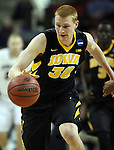 Iowa's Aaron White dribbles up court after getting a rebound against Gonzaga during the 2015 NCAA Division I Men's Basketball Championship's March 22, 2015 at the Key Arena in Seattle, Washington.   Gonzaga beat Iowa 87-67 to advance to the Sweet 16.    ©2015. Jim Bryant Photo. ALL RIGHTS RESERVED.